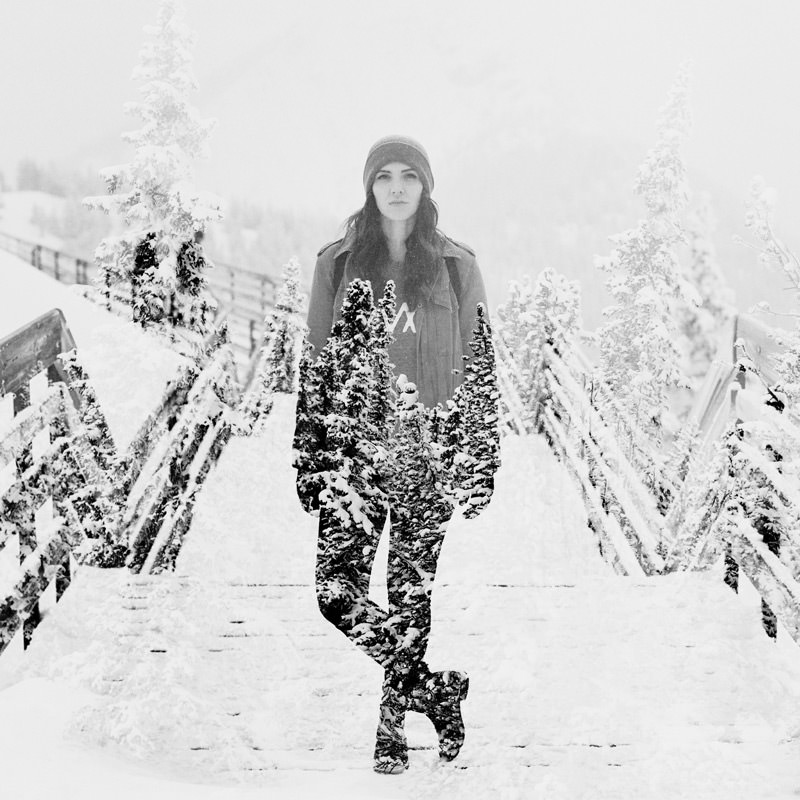double exposure portrait with woman and winter trees