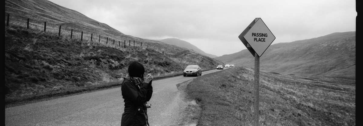 Glen Etive passing place sign in scotland photographing on hasselblad xpan panoramic film camera and kodak trix 400