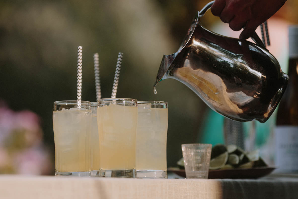lemonade served at wedding with chevron paper straws