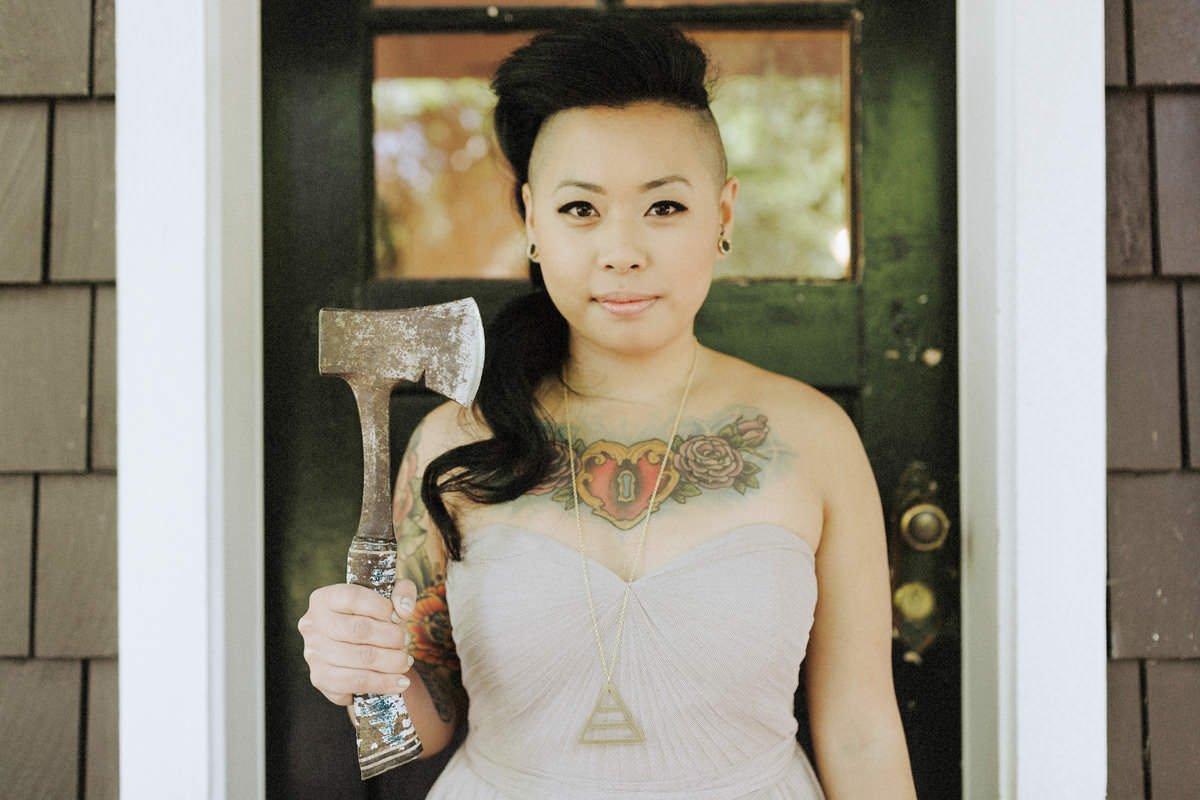 tattooed bridesmaid holding hatchet squamish