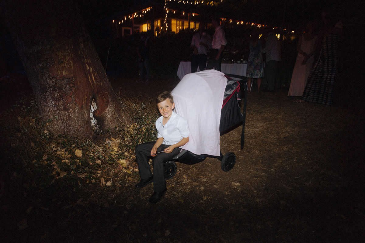 boy sitting at saltspring island wedding