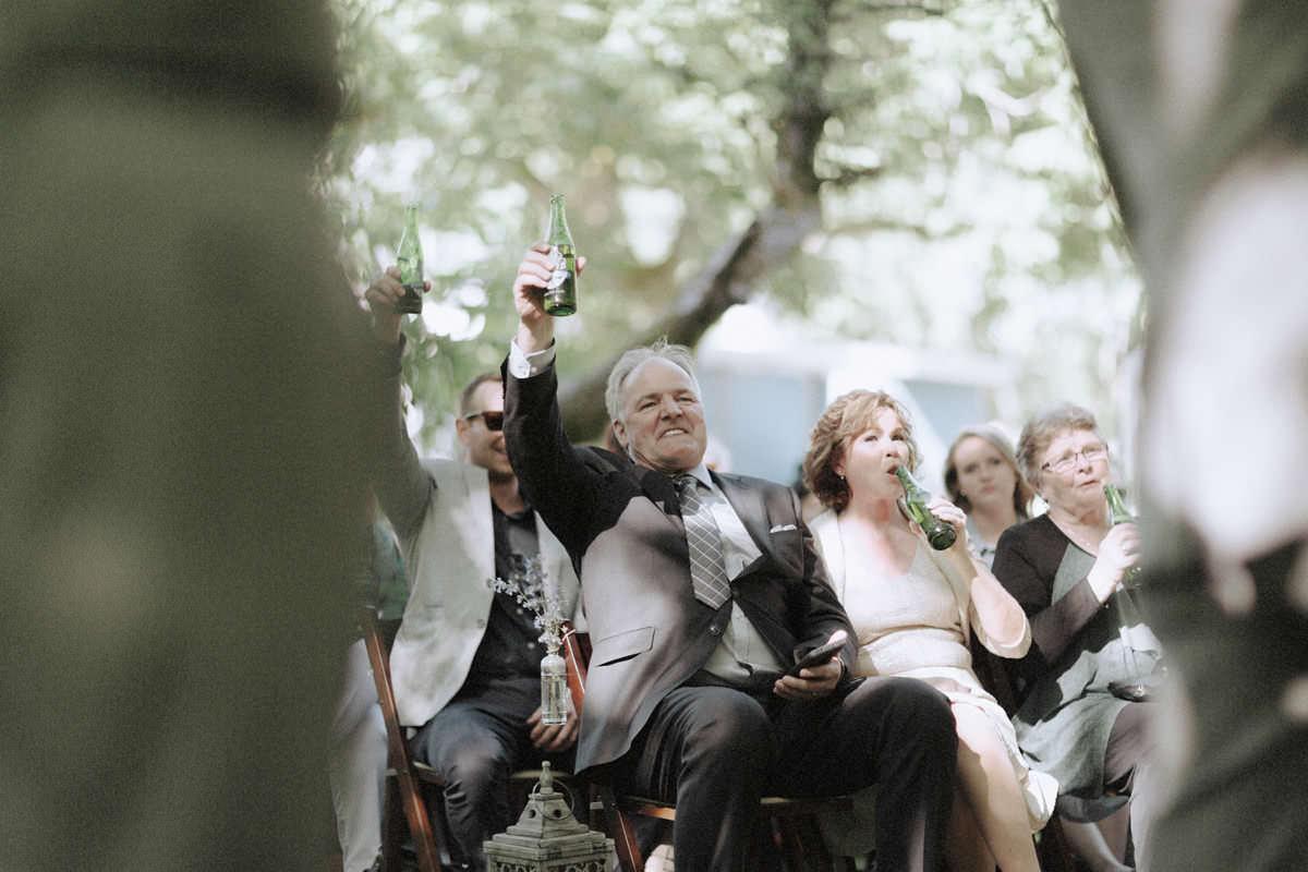 beer salute at campsite wedding