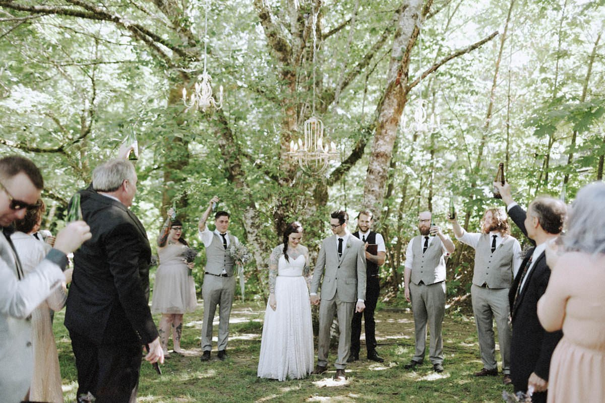 tree chandeliers hanging above wedding ceremony site