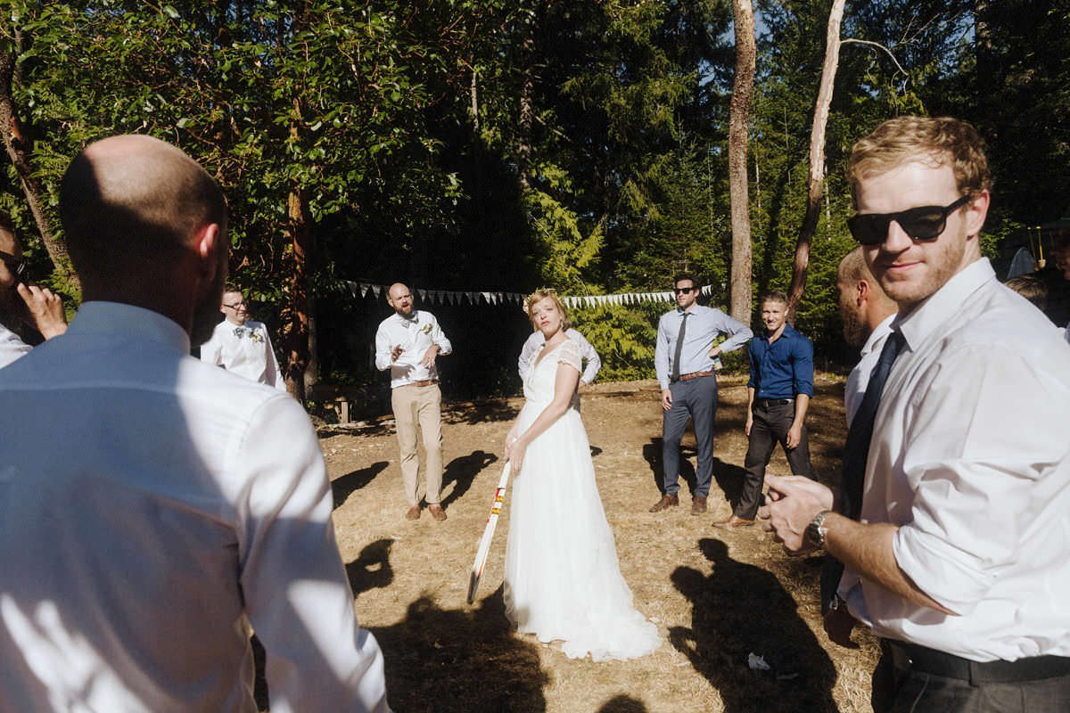 bride playing cricket at her vancouver wedding