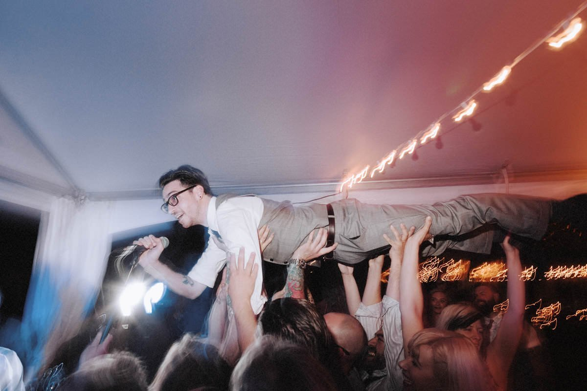 crowdsurfing groom at outdoor whistler wedding