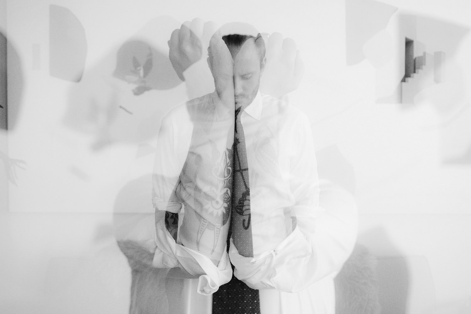 double exposure of tattooed groom in vancouver apartment