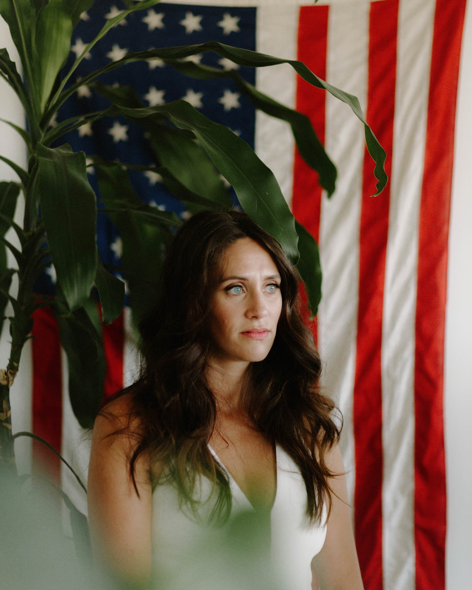 portrait of bride with american flag in apartment