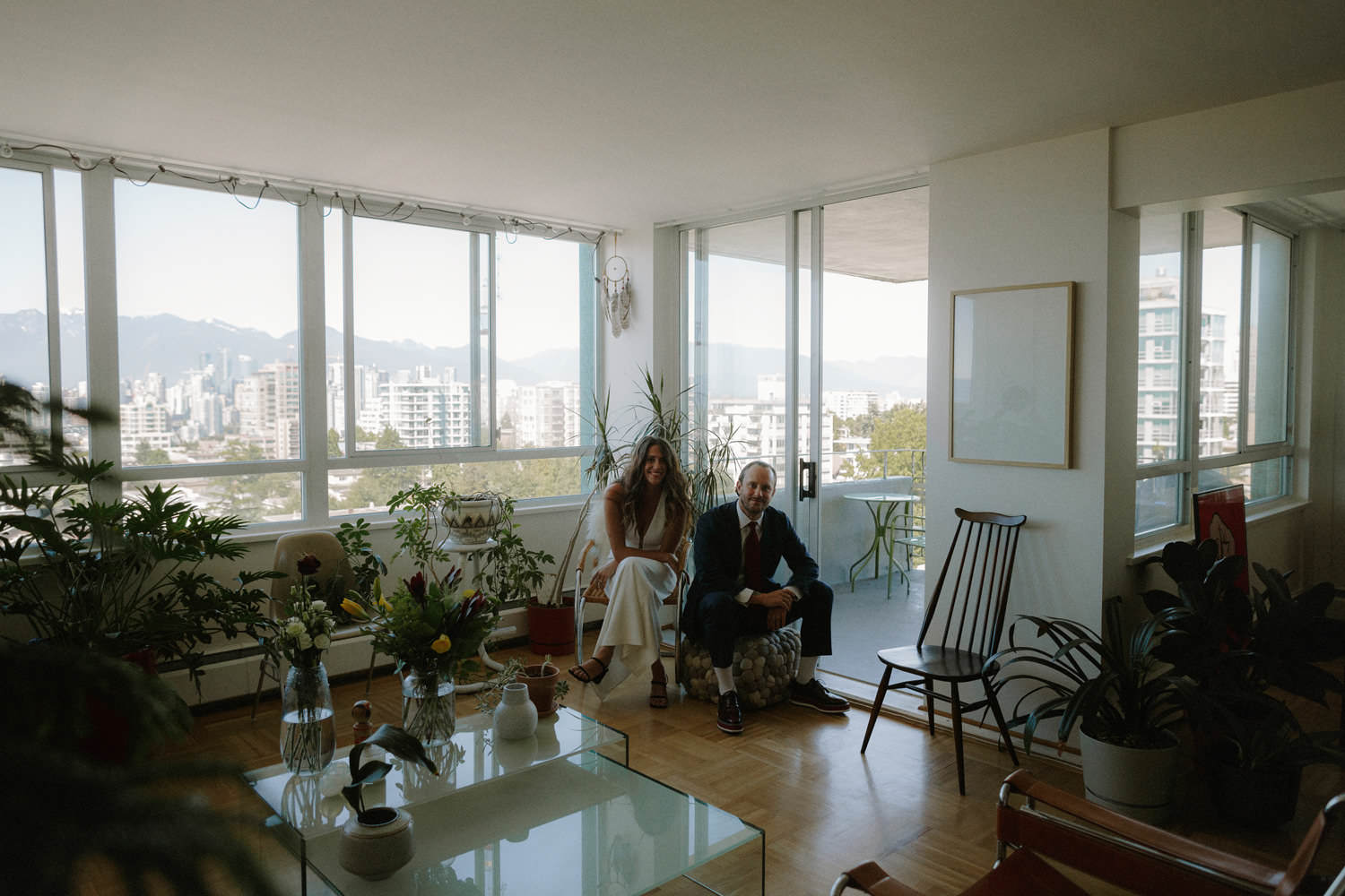 bride and groom in their mid century modern vancouver apartment
