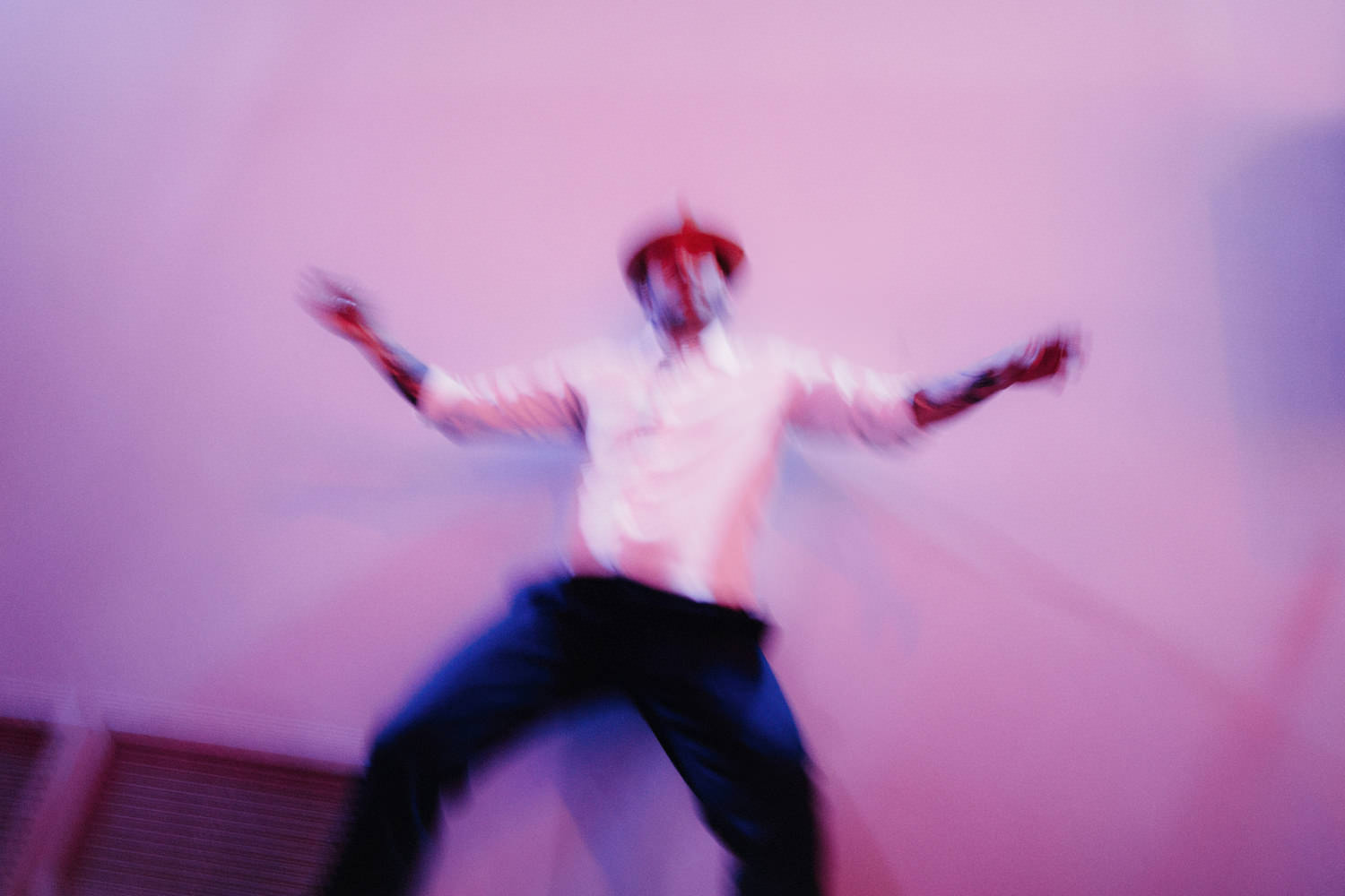 blurry photo of groom dancing
