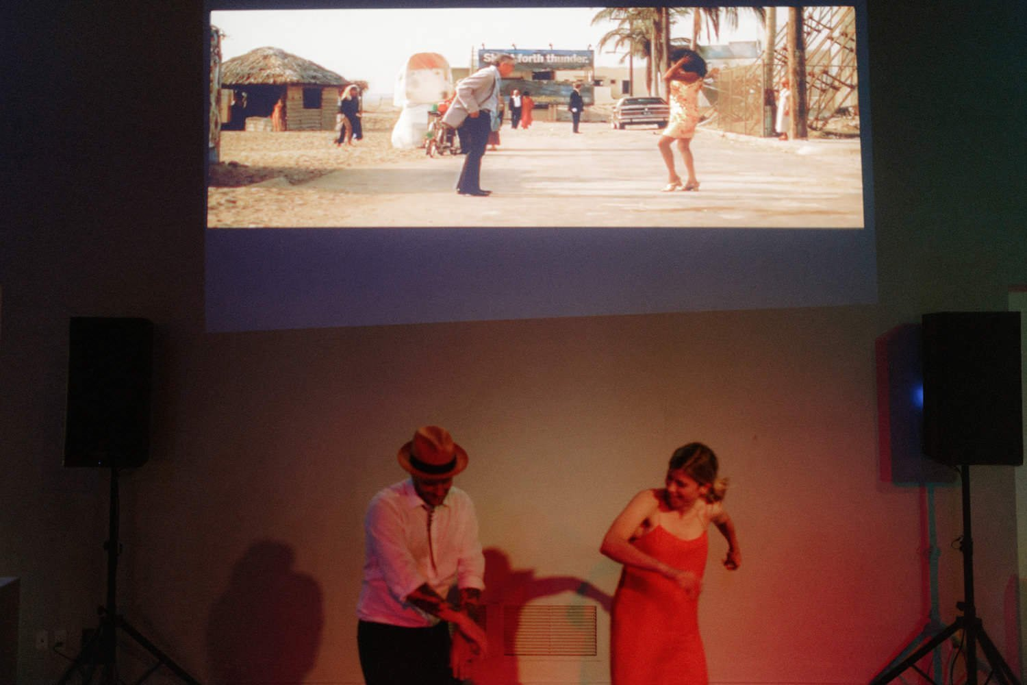 wedding guests dancing with movie projector