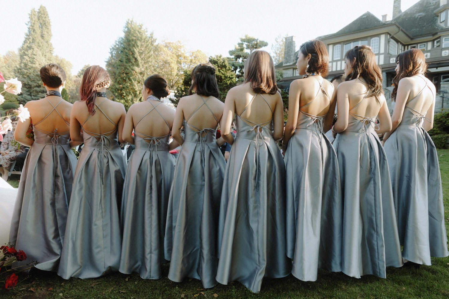 bridesmaids wearing silk silver maxi dresses