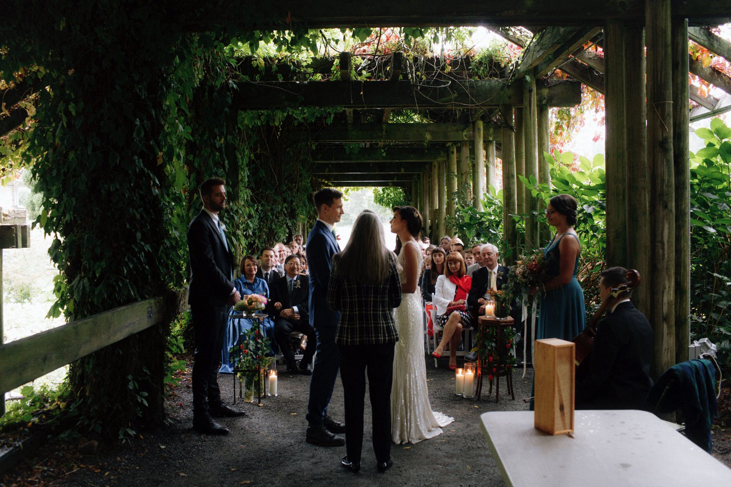 intimate wedding ceremony underneath arbour at ubc botanical garden