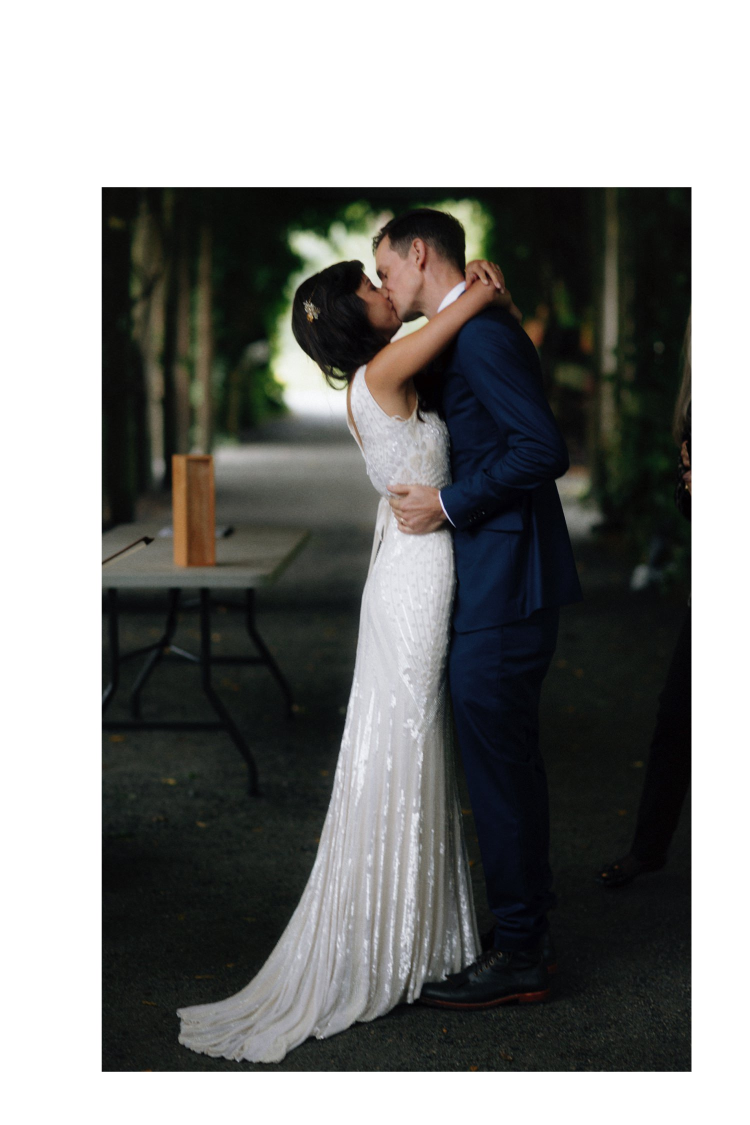 first kiss as bride and groom at ubc botanical garden weding